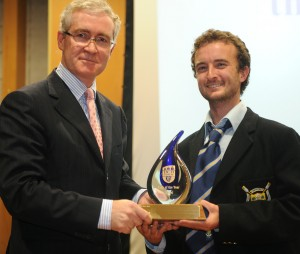 """Captain Naoise Grisewood accepts the trophy for """"UCD Elite Club of the Year"""""""