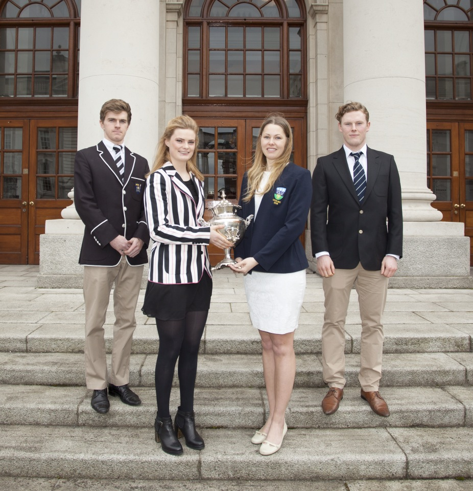 Ladies Boat Club captains Sally O'Brien (Trinity) and Breanna Larsen (UCD) present the Corcoran Cup for Senior Women at Colours 2015